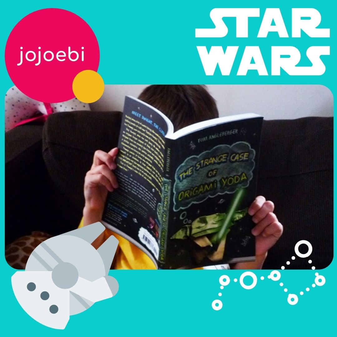 boy reading an educational star wars book