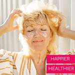 happy looking woman with gloitter on her face