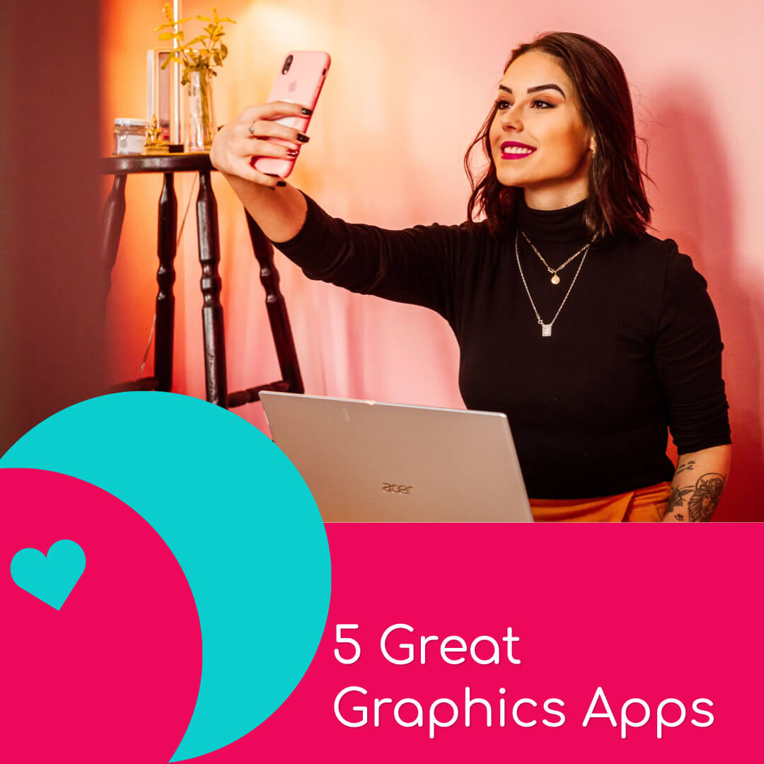 woman taking a selfie sat in front of a laptop to use in a graphics app