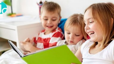 3 kids reading more together sat on a sofa