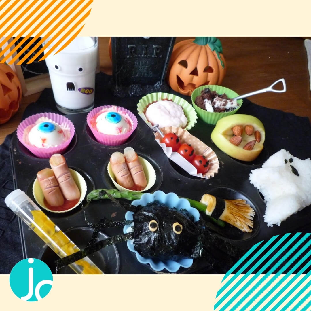 halloween themed muffin tin dinner with eye balls made of eggs and sausage severed fingers